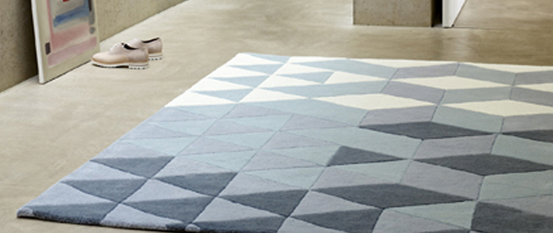 The Trend For Geometric Patterns Shows No Sign Of Slowing Down This Striking Rug Comes In Two Colourways Featuring Dusky Mauve S And Smoky Blues